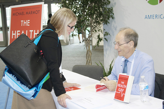 Michael Marmot signs book for fan