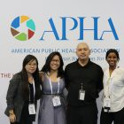 four people in front of APHA logo