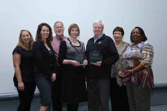 seven people posing with Affiliate award