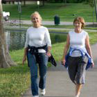 women walking on paved path