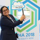 smiling woman in front of APHA 2018 logo