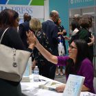 women high fiving at book signing table