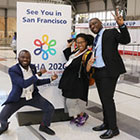three people hamming it up in front of See You in San Francisco sign