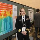 uniformed woman talking about public health poster