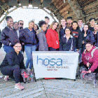 smiling people around 'hosa' banner