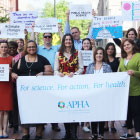 APHA staff holding March for Science signs